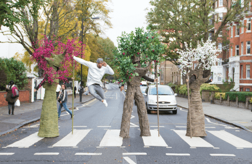 Man jumping in air with trees